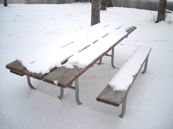 Picnic Table covered in snow